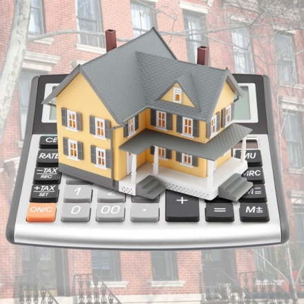 stock-photo-17211177-mortgage-calculator-concept-with-little-house-building-on-it.jpg
